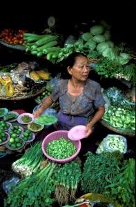 Limes, basil, green onions and fresh coriander sold in Thai fresh market.